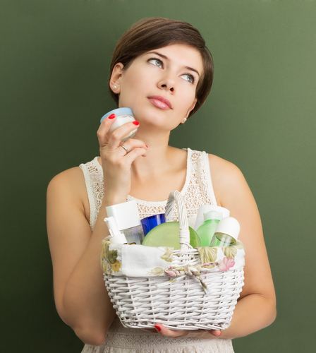 Girl with a basket full of skin care products