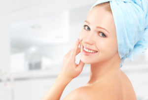 skin care. young beautiful healthy girl in a towel in the bathroom